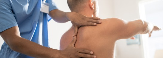 medical specialist in uniform massaging shoulder of an athlete at P3 training institute